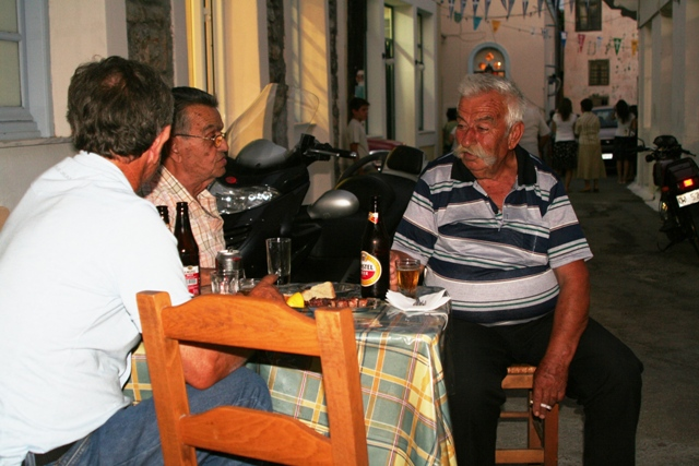 Locals sitting outside the old 'Holy Gyros' in the Old Village
