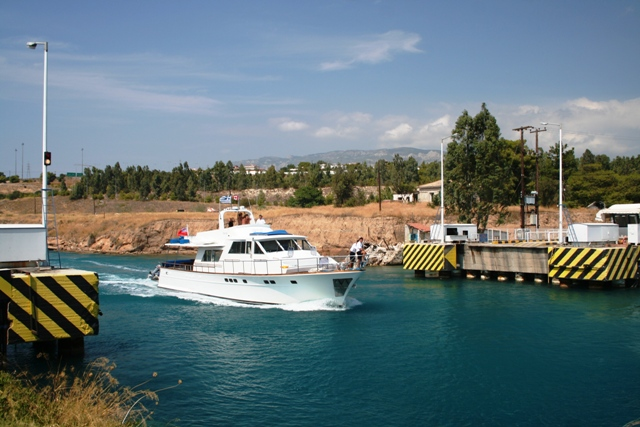 Corinth Canal - Pleasure craft sailing over the submerged bridge