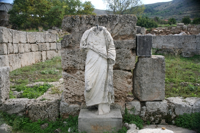Ancient Corinth - One of many Roman statues in ancient Corinth