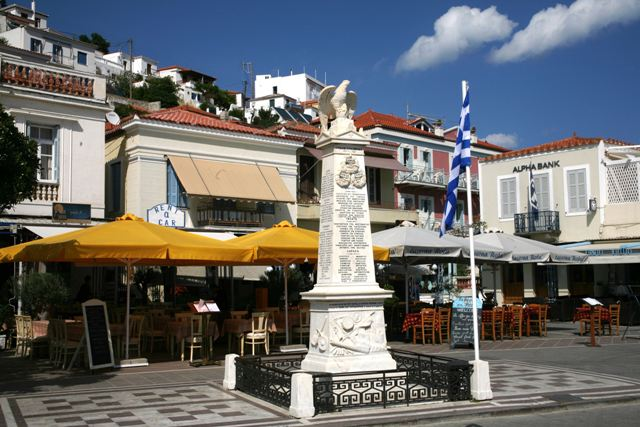 Poros Island - Waterfront war monument surrounded by cafes and tavernas