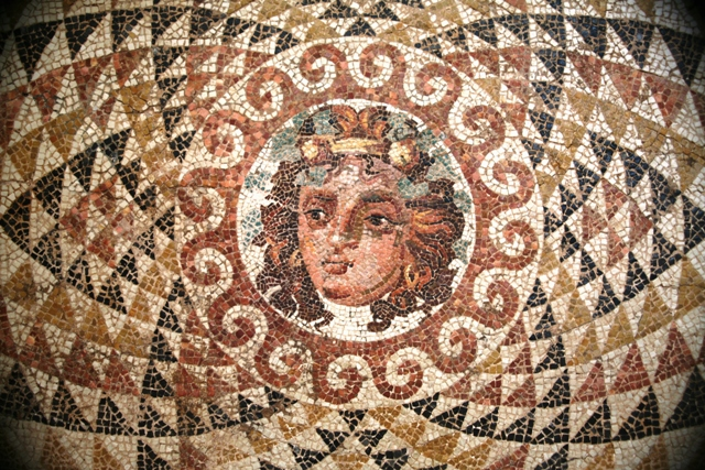 Ancient Corinth - Head of Dionysus on a mosaic from the Roman villa