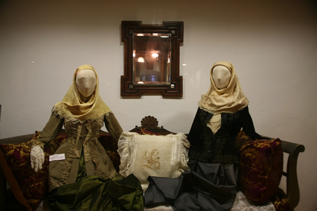 Ermioni wedding dress on display (right) from the late 19th Century