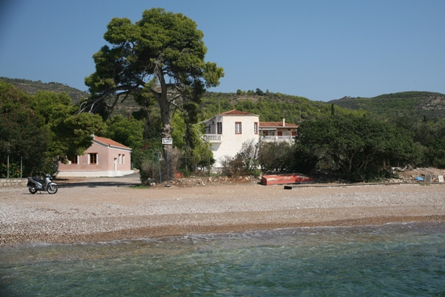 Spetses Island - Church of Ag. Anargyri on the beach alongside tavernas