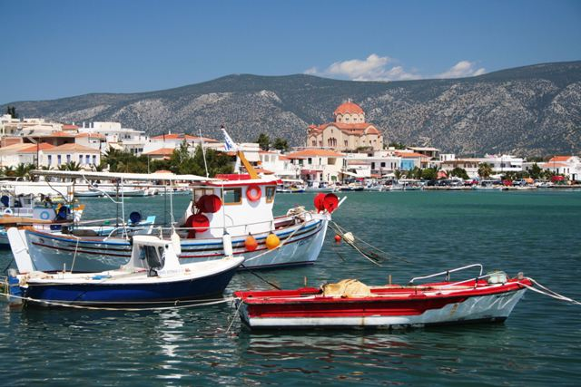 Kilada - Traditional boats with church of Aghios Panteleimon