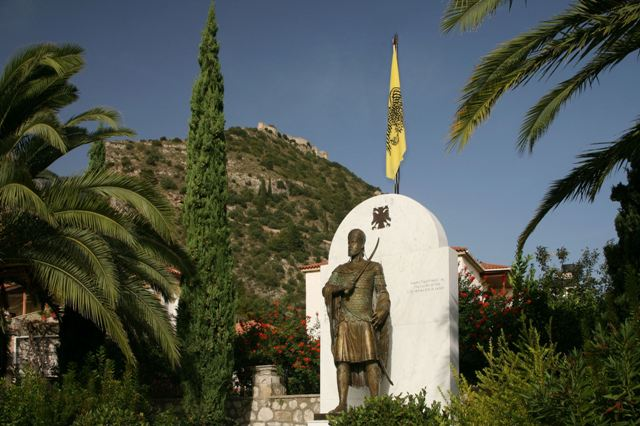 Mystras - Village location of statue with the castle in background