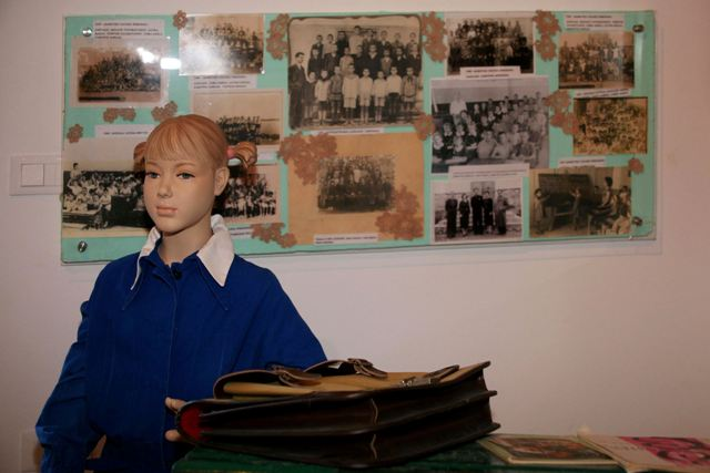 Old school uniform and school photographs on display