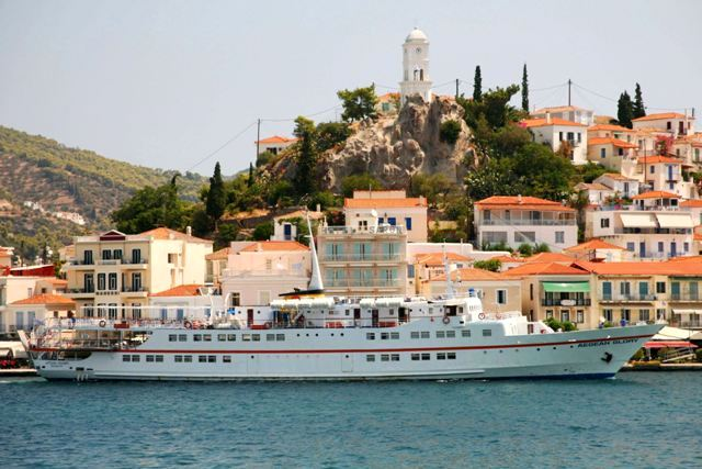 Many cruise ships arrive to Poros from Piraeus