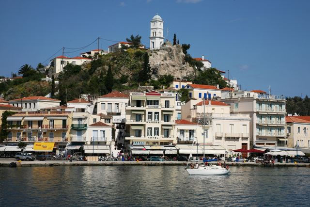 Sailing boats visit Poros on their island-hopping tours