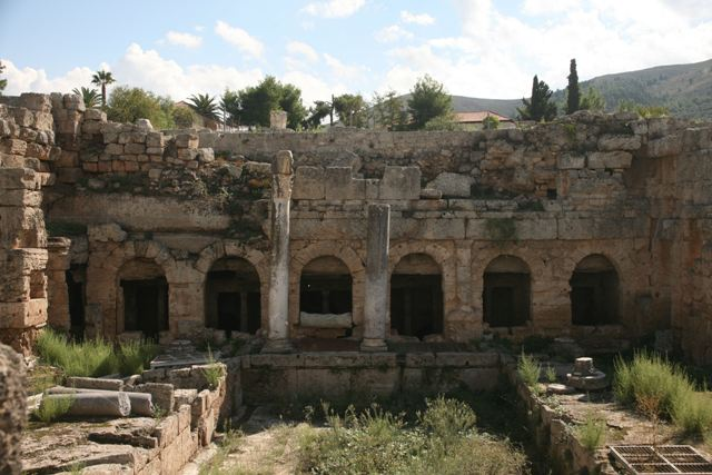 The spring of Peirene with arched openings to draw water