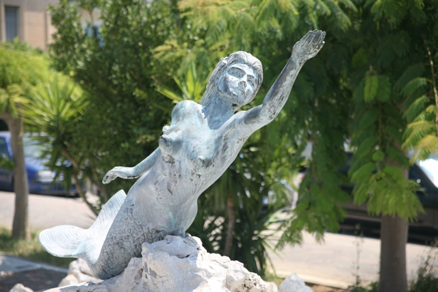 Mermaid fountain statue near the ferry-boat landing