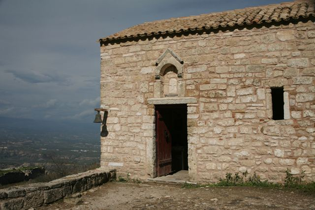 A small Christian church overlooking the bay of Corinth