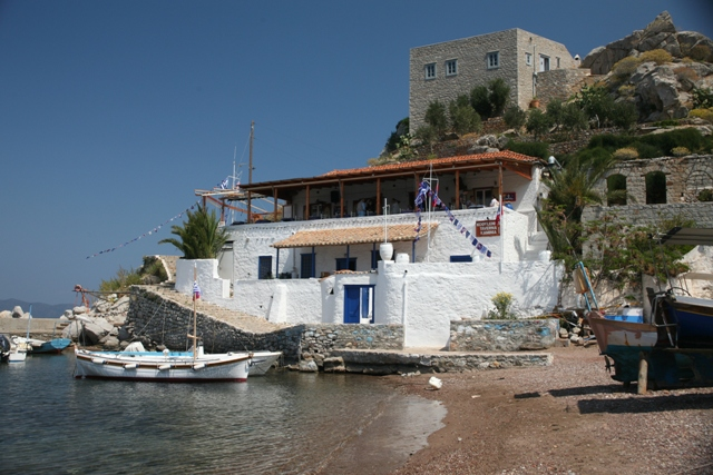 Have a cool drink in the port taverna in Kamini