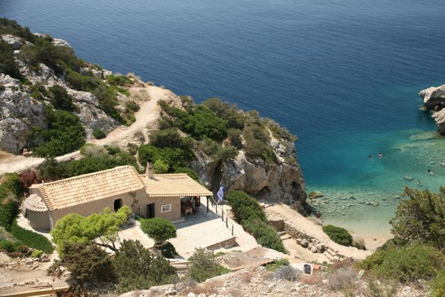 Small church of Aghios Yiannis overlooking the beach