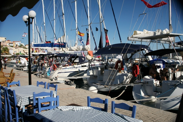 Mandrakia - Flotillas fill the Southern waterfront in Summer