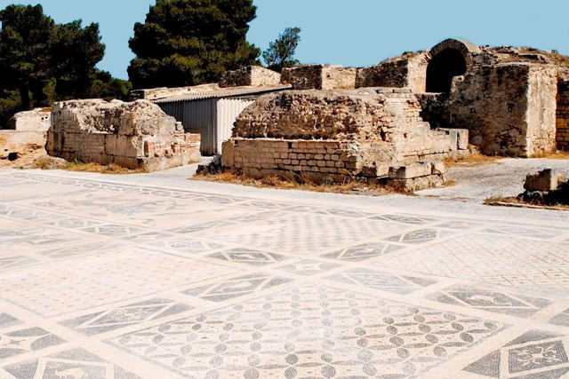 Monochrome mosaic floor at the Isthmia Roman Bath