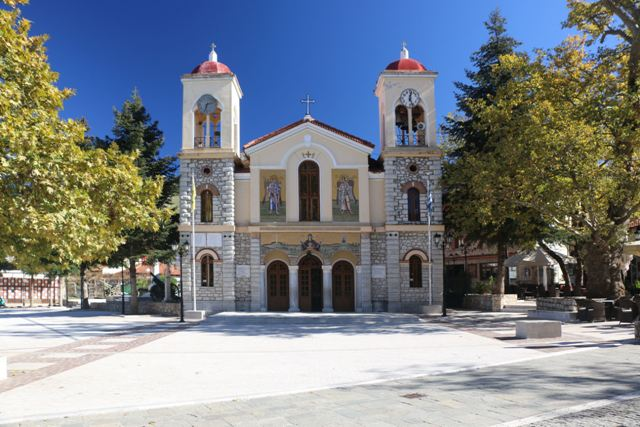 Kalavrita - Cathedral frontage with twin clocks