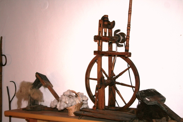 A 19th Century spinning-wheel and accessories