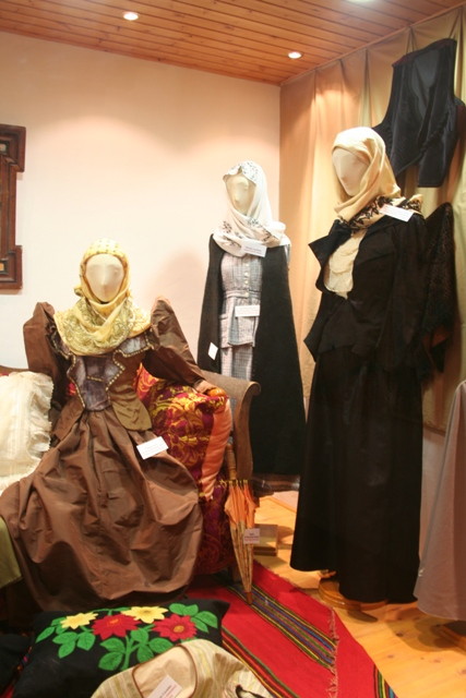 A 19th Century brides wedding dress (on the left)
