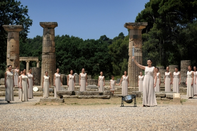 Ancient Olympia - Olympic flame in front of the temple of Hera