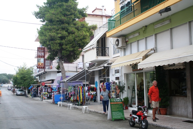 The main street of Tolo is popular with visitors for shopping