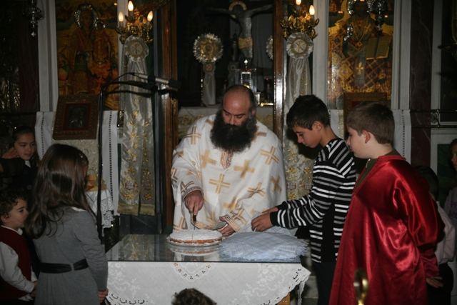 January 1 - St Basil's day - Slicing the 'Vassilopita' cake